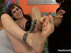 Brunette alexandra giving a footjob