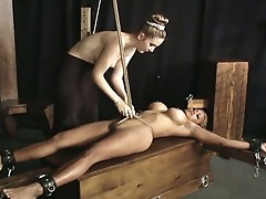 Big tits slut tied up and chained. bound for your pleasure, and hers