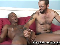 Muscled hairy gay daddy serving monster black cock with hands
