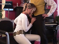 Horny blonde takes a differed lesson from her piano instructor