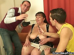Two young dudes get to have their cocks sucked by mature fatty