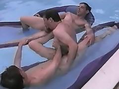 Three gay friends having fun at the swimming pool