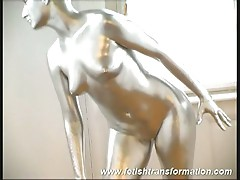 Silver painted dame posing erotically