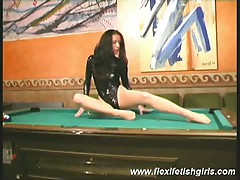 Trinity in all her spandex glory stretches out on pool table