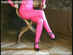 Flexible sexy blonde janine in pink latex suit