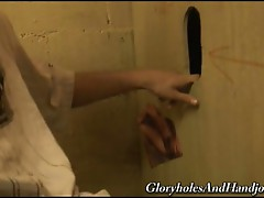 Young white guy suck and jerking a gloryhole black dick