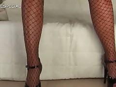 Blonde slut sensually masturbating in her fishnet stockings