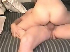 Husband and wife are getting the fuck session in on their bed
