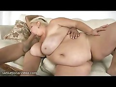 Big old blonde plumper is sucking and fucking a huge hard cock