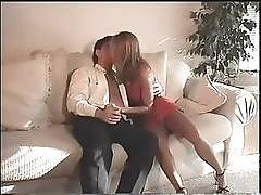 Blonde babe sucks on a fat cock and then fucks it on the couch