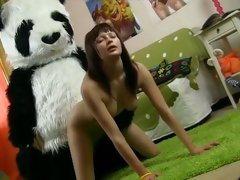 Horny young slut riding a dildo attached to toy panda