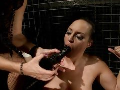 Randy Mandy Bright shoves a dildo in this sluts mouth