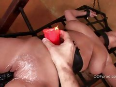 Slutty slave La Taya Roxx loves hot wax dripped on her slit, while tied up
