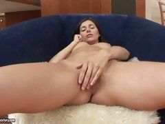 Super slut Monica gets so hot and horny on the couch touching herself