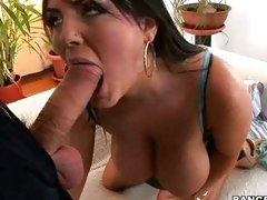 Jasmine Black wraps her sexy lips around a rock hard cock and sucks it off