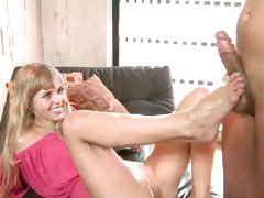 Sexy blonde wanks a cock with her hot toes and feet