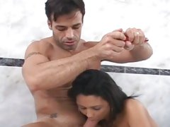 Nasty latina spreads her moist lips round a huge dick