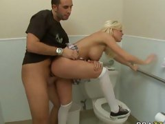 Sexy blond slut Britney Amber being fucked hard over a toilet