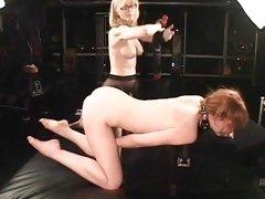 Alluring Nina Hartley spanks a horny Justine Jolie