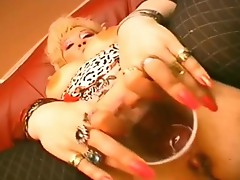 Busty MILF toys involving her pierced vagina