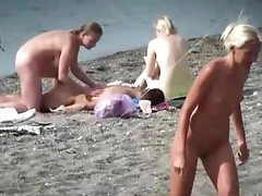 Sexy naked blonde flirting onto the seashore