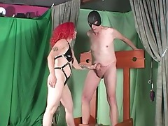 Intense ball beating together with kneeing and  tight rope around male slut's genitals