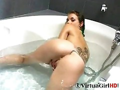 Sandra plays in the bath