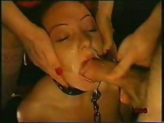 Bondage girl sucks and gets a facial