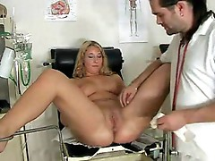 Blonde gets examined on gyno-chair