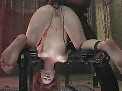 Redhead tests anus in rough bdsm for hot shooting