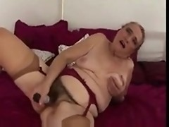 Hairy granny strips to masturbate in the bedroom
