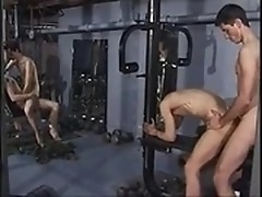Four gays warm up their rods during workout in gym
