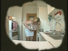 A full-bodied mature goodies is masturbating right in the kitchen!