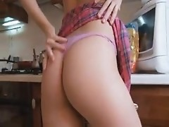 Foxy blonde lady fingers her cunt in the kitchen