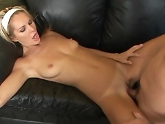 European chick is banged on black leather couch