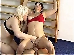 2 matures having fun with guy in the gym