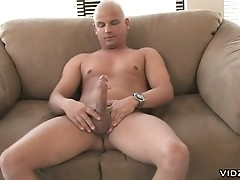 Bald horny dude plays with erect cock