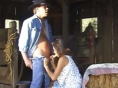 Young cowboy John Decker getting a blowjob in the barn