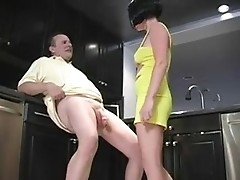 A sexy babe in yellow dress is playing with guy jerking off his Little Willie