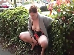 Busty British redhead pisses in the public
