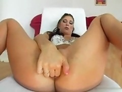 Sexy brunette is undermined by the army of bananas