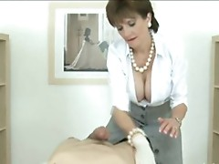 Mature, sexy British milf is making a nice blowjob