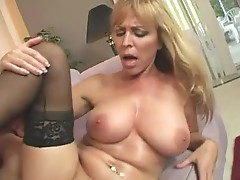 Big boobs of busty Cougar Nicole covered with cum