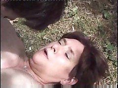 Mature granny is being fucked hard in the open air