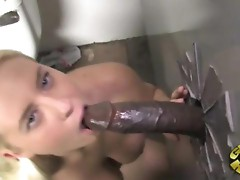 busty amateur blonde sucking off a black gloryhole cock