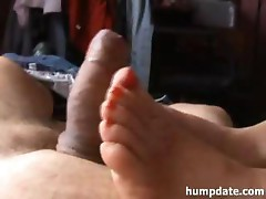 Wife gives hot footjob with quick cumshot