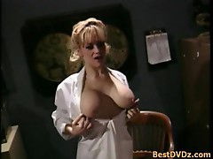 Busty blonde gal poked by two cocks