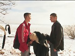Irina with two guys on the snow