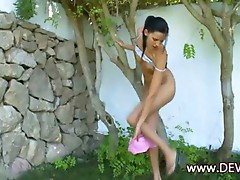 Super thin striptease in the garden
