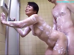 Mature Woman Getting Her Body Washed Ass Rubbed With Cock Giving Blowjob For Young Guy In The Shower